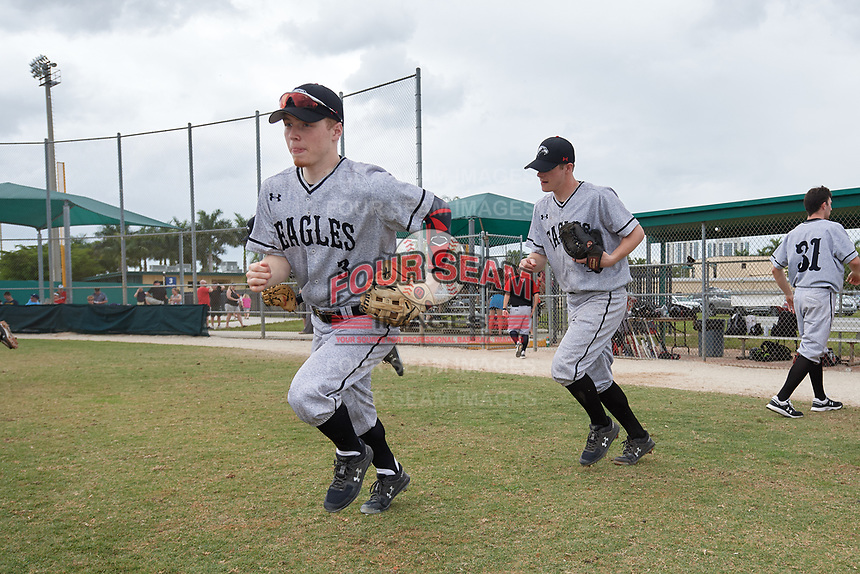 Edgewood Eagles right fielder Adam Cairo (3) and starting pitcher Ryan Fields (9) take the field during the second game of a double header against the Bethel Wildcats on March 15, 2019 at Terry Park in Fort Myers, Florida.  Bethel defeated Edgewood 3-2.  (Mike Janes/Four Seam Images)