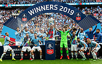 Captain Vincent Kompany of Manchester City celebrates with the FA Cup with his teammates during the FA CUP FINAL match between Manchester City and Watford at Wembley Stadium, London, England on 18 May 2019. Photo by Andy Rowland.