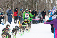 Ryan Redington and team run past spectators on the bike/ski trail near University Lake with an Iditarider in the basket and a handler during the Anchorage, Alaska ceremonial start on Saturday, March 7 during the 2020 Iditarod race. Photo © 2020 by Ed Bennett/Bennett Images LLC