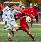 CHESHIRE, CT-111220JS10—North Haven's Donovan Luna (26) and Cheshire's Austin Goldberg (34) run down a loose ball during their SCC Division A semifinal game Thursday at Cheshire High School.<br /> Jim Shannon Republican-American