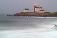 A fogged in sunrise at Watch Hill Light