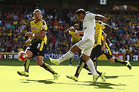 Jefferson Montero of Swansea crosses the ball  during the Barclays Premier League match Watford and Swansea   played at Vicarage Road Stadium , Watford