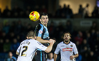 Matt Bloomfield of Wycombe Wanderers keeps eyes on the ball during the Sky Bet League 2 match between Wycombe Wanderers and Notts County at Adams Park, High Wycombe, England on 15 December 2015. Photo by Andy Rowland.