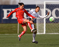 Sarah Huffman of the Washington Freedom fights for the ball with Estelle Johnson of the Philadelphia Independence during their preseason game at the Maryland SoccerPlex in Germantown, Maryland.