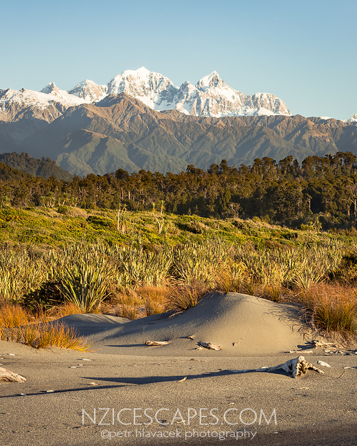 Southern Alps with Mt. Tasman and Aoraki Mt. Cook as seen from near Okarito, Westland Tai Poutini National Park, West Coast, South Westland, UNESCO World Heritage Area, New Zealand, NZ