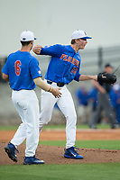 Florida Gators starting pitcher Brady Singer (51) yells in the direction of the home plate umpire, wanting him to get the inning started against the Wake Forest Demon Deacons, as teammate Jonathan India (6) tries to calm him down during Game Three of the Gainesville Super Regional of the 2017 College World Series at Alfred McKethan Stadium at Perry Field on June 12, 2017 in Gainesville, Florida.  (Brian Westerholt/Four Seam Images)