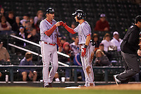 Syracuse Chiefs center fielder Trea Turner (7) fist bumps manager Billy Gardner (24) after hitting a triple during a game against the Rochester Red Wings on July 1, 2016 at Frontier Field in Rochester, New York.  Rochester defeated Syracuse 5-3.  (Mike Janes/Four Seam Images)