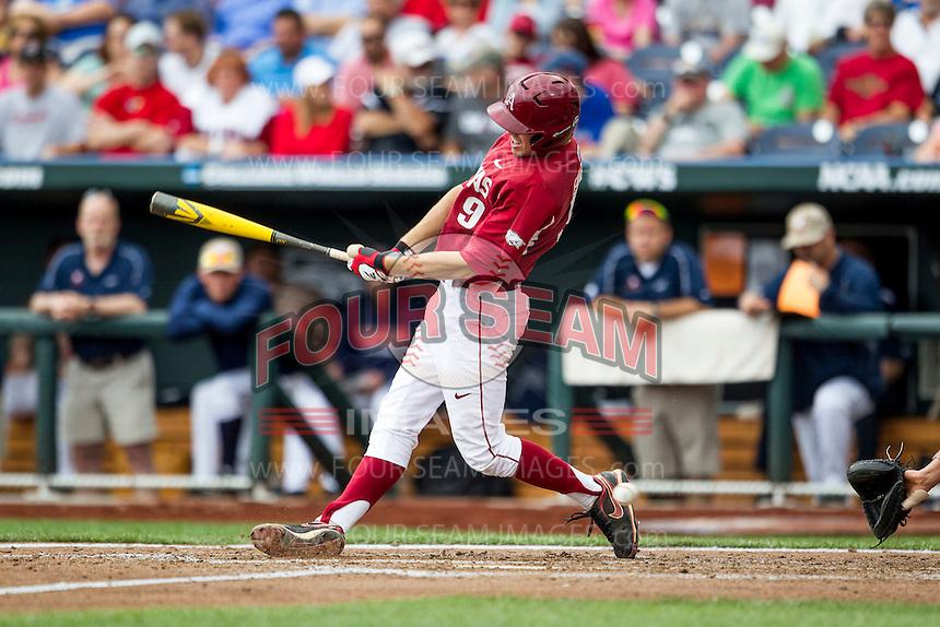 Arkansas Razorbacks first baseman Clark Eagan (9) swings the bat against the Virginia Cavaliers in Game 1 of the NCAA College World Series on June 13, 2015 at TD Ameritrade Park in Omaha, Nebraska. Virginia defeated Arkansas 5-3. (Andrew Woolley/Four Seam Images)