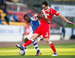 St Johnstone v Ross County...17.11.12      SPL.Nigel Hasselbaink holds off Marc Fitzpatrick.Picture by Graeme Hart..Copyright Perthshire Picture Agency.Tel: 01738 623350  Mobile: 07990 594431