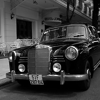 vintage mercedes car in front of the Continental hotel, Ho Chi Minh City, Vietnam <br /> <br /> PHOTO : Roussel Fine Art Photo