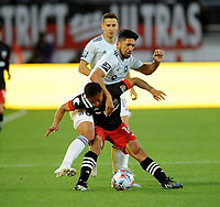 WASHINGTON, DC - MAY 13: Andy Najar #14 of D.C. United battles for the ball with Mauricio Pineda #22 of Chicago Fire during a game between Chicago Fire FC and D.C. United at Audi FIeld on May 13, 2021 in Washington, DC.