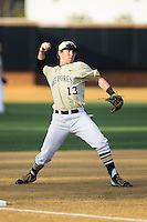 Wake Forest Demon Deacons third baseman Keegan Maronpot (13) makes a throw to first base between innings of the game against the UConn Huskies at Wake Forest Baseball Park on March 17, 2015 in Winston-Salem, North Carolina.  The Demon Deacons defeated the Huskies 6-2.  (Brian Westerholt/Four Seam Images)