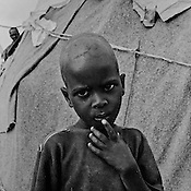A young Somali refugee boy at the IFO-1 camp in the Dadaab refugee camp in northeastern Kenya. Hundreds of thousands of refugees are fleeing lands in Somalia due to severe drought and arriving in what has become the world's largest refugee camp. Photo: Sanjit Das/Panos