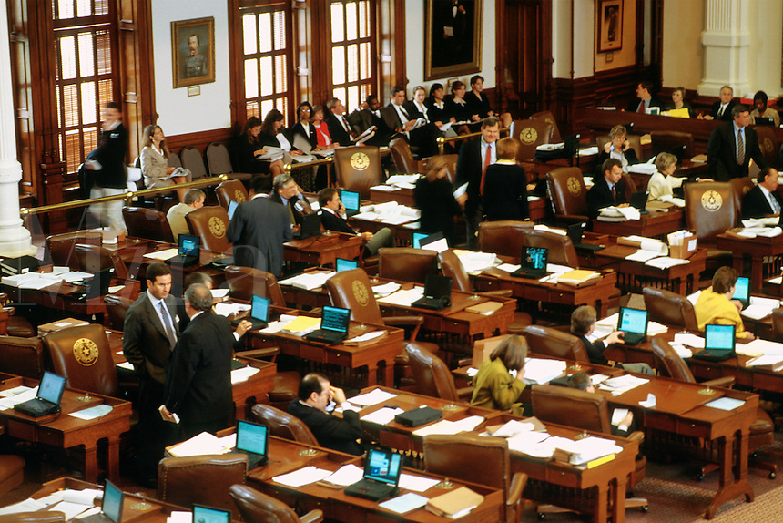 State government. Texas Legislature. 76th Legislative session. Lawmakers. Laptop computers connected by LAN on each legislator's desk allow them to vote electronically. Austin Texas.
