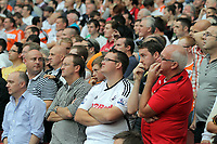 Pictured: Swansea City fans in action. Saturday 10 September 2011<br /> Re: Premiership Arsenal v Swansea City FC at the Emirates Stadium, London.