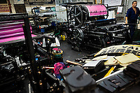 A Colombian master printer prepares the ancient letterpress machine for a new load in the print shop in Cali, Colombia, 2 June 2012. Letterpress printing, invented by Johannes Gutenberg in the 15th century, remained the primary way to print and distribute information until the second half of the 20th century. The process of letterpress printing consists of composing movable types into the bed of a press, inking it, and pressing paper against it to create an impression. Nowadays, due to the offset printing expansion, there are few commercial print shops in the world keeping this traditional craftsmanship alive.