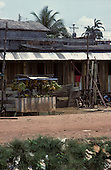 Manaus, Brazil. Wooden and corrugated iron shack with stall selling bananas in front.