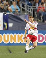 New York Red Bulls defender Markus Holgersson (5) passes the ball. Despite a red-card man advantage, in a Major League Soccer (MLS) match, the New England Revolution tied New York Red Bulls, 1-1, at Gillette Stadium on September 22, 2012.