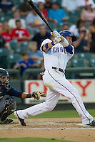 Round Rock Express outfielder Jim Adduci (24) swings the bat against the Oklahoma City RedHawks during the Pacific Coast League baseball game on August 25, 2013 at the Dell Diamond in Round Rock, Texas. Round Rock defeated Oklahoma City 9-2. (Andrew Woolley/Four Seam Images)