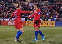 COLUMBUS, OH - NOVEMBER 07: Emily Sonnett #14 and Carli Lloyd #10 of the United States celebrate during a game between Sweden and USWNT at Mapfre Stadium on November 07, 2019 in Columbus, Ohio.