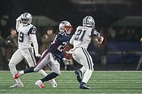 FOXBOROUGH, MA - NOVEMBER 24: Dallas Cowboys Runningback Ezekiel Elliott #21 chased down by New England Patriots Cornerback Stephon Gilmore #24 during a game between Dallas Cowboys and New England Patriots at Gillettes on November 24, 2019 in Foxborough, Massachusetts.