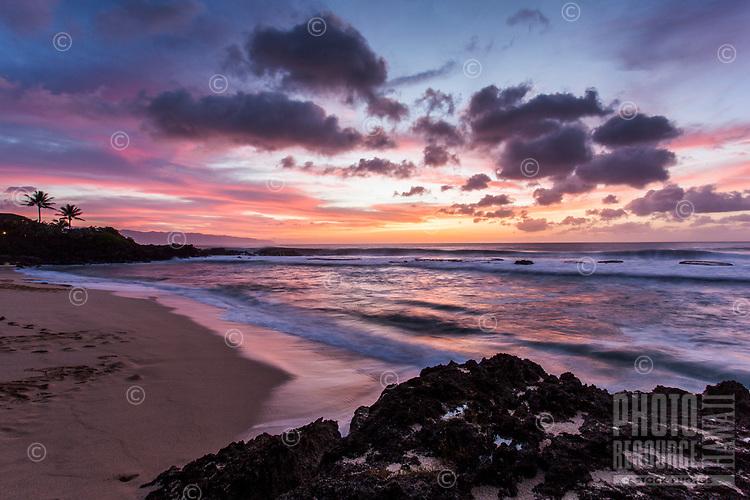 Colorful sunset at Three Tables Beach, North Shore, O'ahu.