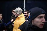 Ein mutmaßlicher Kollaborateur wird auf der Bühne präsentiert. Er wird dann abgeschirmt und von Milizionären abtransportiert, zentrale Trauerveranstaltung in Lemberg, die Portraits der getöteten hängen an provisorischen Wänden die Menschen stellen Kerzen auf / A collaborateur is being presented on the stage, later was taken away by the police,  Mourning for the death in Lviv the portraits of the death are hanging on a improvised wall People bring candels.