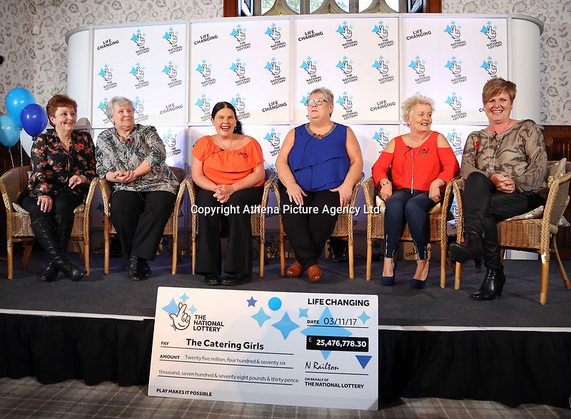 Pictured L-R: Jule Saunders, Jean Cairns, Louise Ward, Sian Jones, Doreen Thompson and Julie Amphlett. Wednesday 08 November 2017<br />Re: Presentation of hospital catering syndicate win £25m in Euromillions Jackpot at Hensol Castle, south Wales, UK. Julie Saunders, 56, Doreen Thompson, 56, Louise Ward, 37, Jean Cairns, 73, SIan Jones, 54 and Julie Amphlett, 50 all work as catering staff for Neath Port Talbot Hospital in south Wales.
