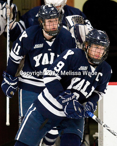 Charles Brockett (Yale - 11), Brian O'Neill (Yale - 9) - The Harvard University Crimson defeated the visiting Yale University Bulldogs 8-2 in the third game of their ECAC Quarterfinal matchup on Sunday, March 11, 2012, at Bright Hockey Center in Cambridge, Massachusetts.