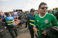 MEXICO CITY, MEXICO - June 11, 2017:  A Mexico police officer directs a Mexico fan away from the USA fans attening the World Cup Qualifier match against Mexico at Azteca Stadium.