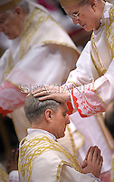 Monsignor Georg Gaenswein private secretary to Pope Benedict XVI Cardinal Tarcisio Bertone after he was elevated as a bishop during the Epiphany mass in St. Peter's Basilica on January 6, 2013.