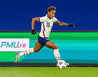 LE HAVRE, FRANCE - APRIL 13: Crystal Dunn of the USWNT dribbles during a game between France and USWNT at Stade Oceane on April 13, 2021 in Le Havre, France.