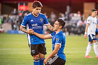 SAN JOSE, CA - MAY 01: Javier Eduardo Lopez #9 of the San Jose Earthquakes helps team mate Cristian Espinoza #10 of the San Jose Earthquakes up during a game between San Jose Earthquakes and D.C. United at PayPal Park on May 01, 2021 in San Jose, California.