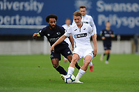 Monday 20th August 2018<br /> Pictured: Derby County's Ikechi Anya vies for possession with Swansea City's George Byers<br /> Re: Swansea City U23 v Derby County U23 Premier League 2 match at the Landore Training facility, Swansea, Wales, UK