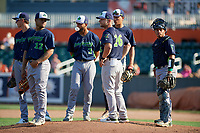 Vermont Lake Monsters Aaron Nieckula (26) makes a pitching change during a NY-Penn League game against the Aberdeen IronBirds on August 18, 2019 at Leidos Field at Ripken Stadium in Aberdeen, Maryland.  Vermont defeated Aberdeen 6-5.  Others shown (L-R) Jordan Diaz (12), Logan Davidson (3), Yerdel Vargas (2), Dustin Harris (21), catcher Jorge Gordon (9).  (Mike Janes/Four Seam Images)