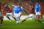 Aberdeen v St Johnstone..22.12.12      SPL.Chris Millar is tackled by Mitch Megginson.Picture by Graeme Hart..Copyright Perthshire Picture Agency.Tel: 01738 623350  Mobile: 07990 594431