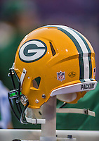 14 December 2014: Green Bay Packers outside linebacker Clay Matthews' helmet is kept warm on the bench in the first quarter against the Buffalo Bills at Ralph Wilson Stadium in Orchard Park, NY. The Bills defeated the Packers 21-13, snapping the Packers' 5-game winning streak and keeping the Bills' 2014 playoff hopes alive. Mandatory Credit: Ed Wolfstein Photo *** RAW (NEF) Image File Available ***