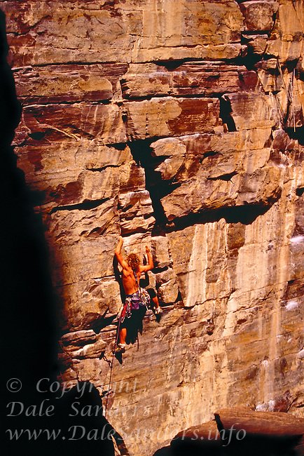700-21832<br /> © Dale Sanders<br /> Man Rock-Climbing<br /> Banff National Park<br /> Alberta, Canada                Model Released
