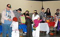 Marc Hayot/Siloam Sunday. Dalton Marsh (left), Madison Hodge, Bliss Wilson, Kyra Ruch, Marinda Szabo, Spencer Bailey help kids with the games at the Boys and Girls Club Halloween party.