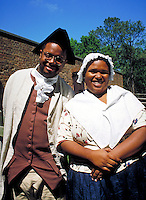 black couple dressed in colonial period dress at Williamsburg historic site. Ethnic, African American, Afro-American. adult black couple. Williamsburg Virginia USA.