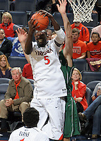 CHARLOTTESVILLE, VA- NOVEMBER 26:  Assane Sene #5 of the Virginia Cavaliers grabs a rebound during the game on November 26, 2011 at the John Paul Jones Arena in Charlottesville, Virginia. Virginia defeated Green Bay 68-42. (Photo by Andrew Shurtleff/Getty Images) *** Local Caption *** Assane Sene