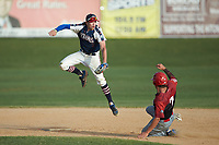 Max Hildreth (7) (Memphis) of the High Point-Thomasville HiToms leaps for a throw as Dayton Brune (7) (Spartanburg Methodist College) of the Deep River Muddogs slides into second base at Finch Field on June 27, 2020 in Thomasville, NC.  The HiToms defeated the Muddogs 11-2. (Brian Westerholt/Four Seam Images)