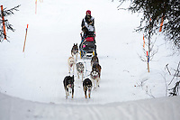 Bailey Schaeffer runs on the inbound trail towards the finish line of the 2016 Junior Iditarod in Willow, Alaska, AK  February 28, 2016