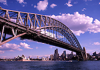 View of the Sydney skyline as seen from under the Harbor Bridge; the Opera House in the distance. Australia.