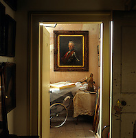 A portrait of Henry of Prussia by Anton Graff presides over a pram in one of the attics