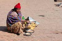 Nepal, Patan.  Women in Durbar Square Selling Corn, to Feed to Pigeons.