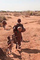Hamer mother and her children going to the Turmi village market in Ethiopia
