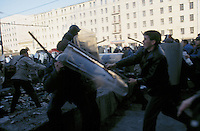 Moscow, Russia, 03/10/1993..Anti-Government demonstrators battle riot police attempting to prevent them from reaching the Russian parliament. When President Boris Yeltsin dissolved the opposition-dominated Russian Parliament,  deputies and supporters, led by Vice President Alexander Rutskoi, barricaded themselves inside the White House. After a 10 day stand-off the situation exploded into violence between pro and anti Yeltsin forces.