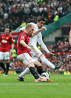 Pictured L-R: Paul Scholes of Manchester United challenged by Pablo Hernandez of Swansea. Sunday 12 May 2013<br /> Re: Barclay's Premier League, Manchester City FC v Swansea City FC at the Old Trafford Stadium, Manchester.