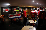 Llandudno 2 Denbigh Town 2, 20/03/2015. Maesdu Park, Huws Gray Alliance Football League. Denbigh Town players in the bar after the game. A painting of George Best hangs on the wall in the background . Needing a win to guarantee promotion to the top division of Welsh football for the first time, Llandudno took the lead twice, but were held to a draw against Denbigh Town.<br /> Llandudno installed an artificial 3G pitch in 2014. The pitch is available for hire, and enables to club to have an active community programme, and teams in every age range, all playing at Maesdu Park. Photo by Paul Thompson.